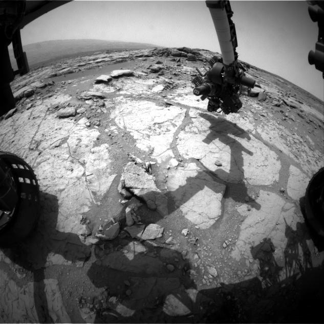 "NASA's Mars rover Curiosity used its front left Hazard-Avoidance Camera for this image of the rover's arm over the drilling target ""Cumberland"" during the 275th Martian day, or sol, of the rover's work on Mars (May 15, 2013)."