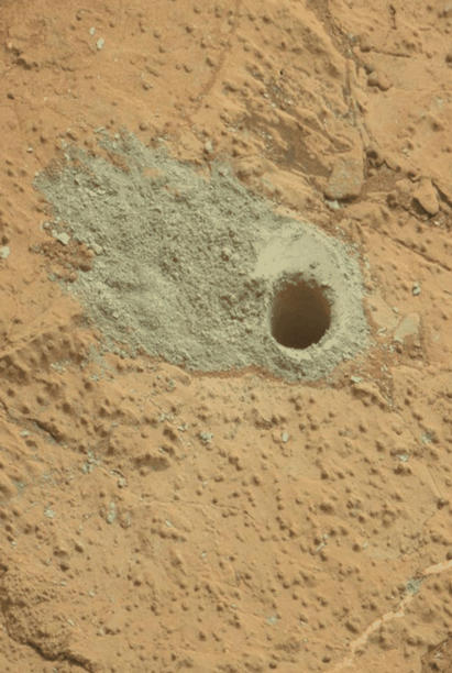 "This pair of images from the Mars Hand Lens Imager (MAHLI) on NASA's Mars rover Curiosity shows the rock target ""Cumberland"" before and after Curiosity drilled into it to collect a sample for analysis."