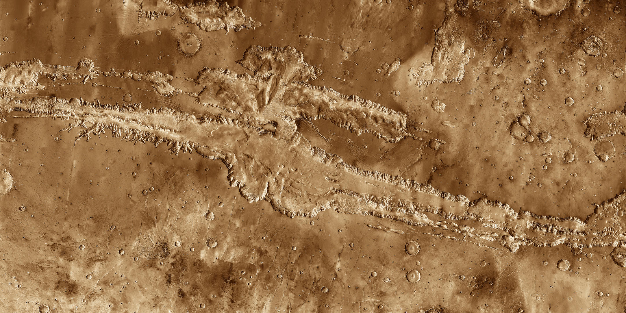 This mosaic image of Valles Marineris - colored to resemble the martian surface - comes from the Thermal Emission Imaging System (THEMIS), a visible-light and infrared-sensing camera on NASA's Mars Odyssey orbiter.