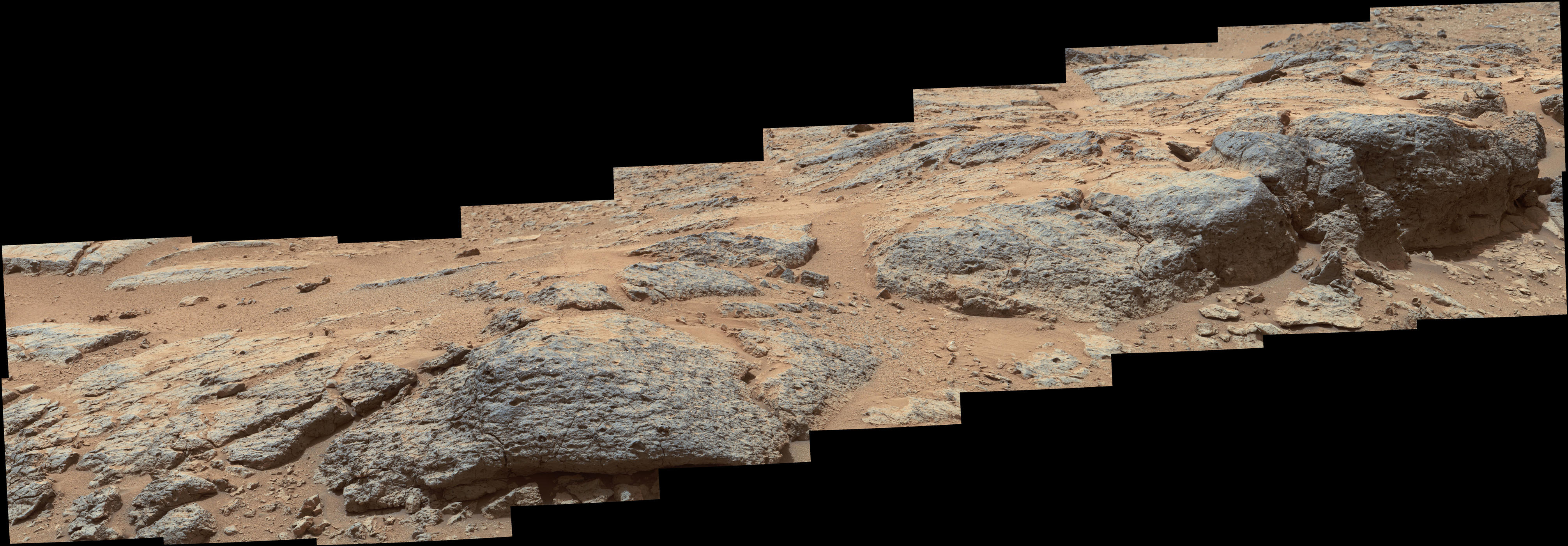 "This mosaic view from the Mast Camera (Mastcam) on NASA's Mars rover Curiosity shows textural characteristics and shapes of an outcrop called ""Point Lake."""