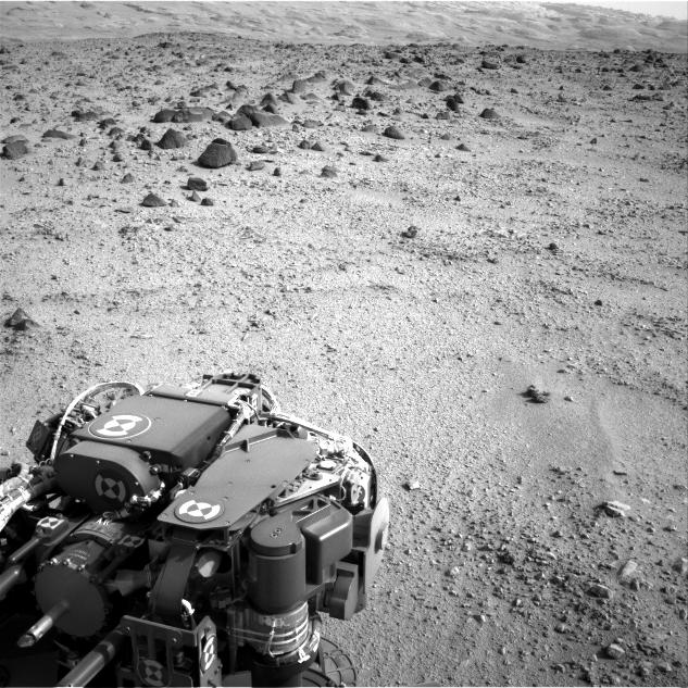 Mars rover Curiosity at the end of a drive of about 135 feet (41 meters) during the 329th Martian day, or sol, of the rover's work on Mars (July 9, 2013).