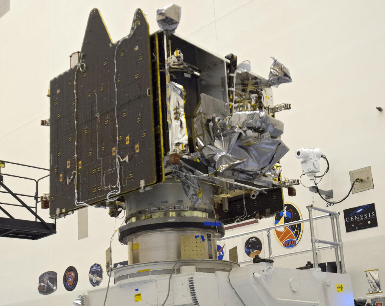 Technicians and engineers oversee MAVEN after it was attached to a processing stand.