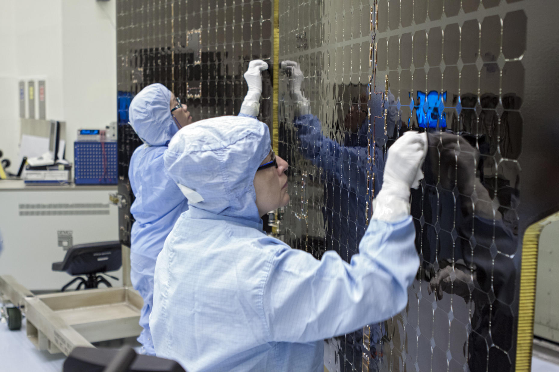 Inside Kennedy's Payload Hazardous Servicing Facility technicians clean the electricity-producing solar arrays for the Mars Atmosphere and Volatile Evolution (MAVEN) spacecraft Aug. 28.