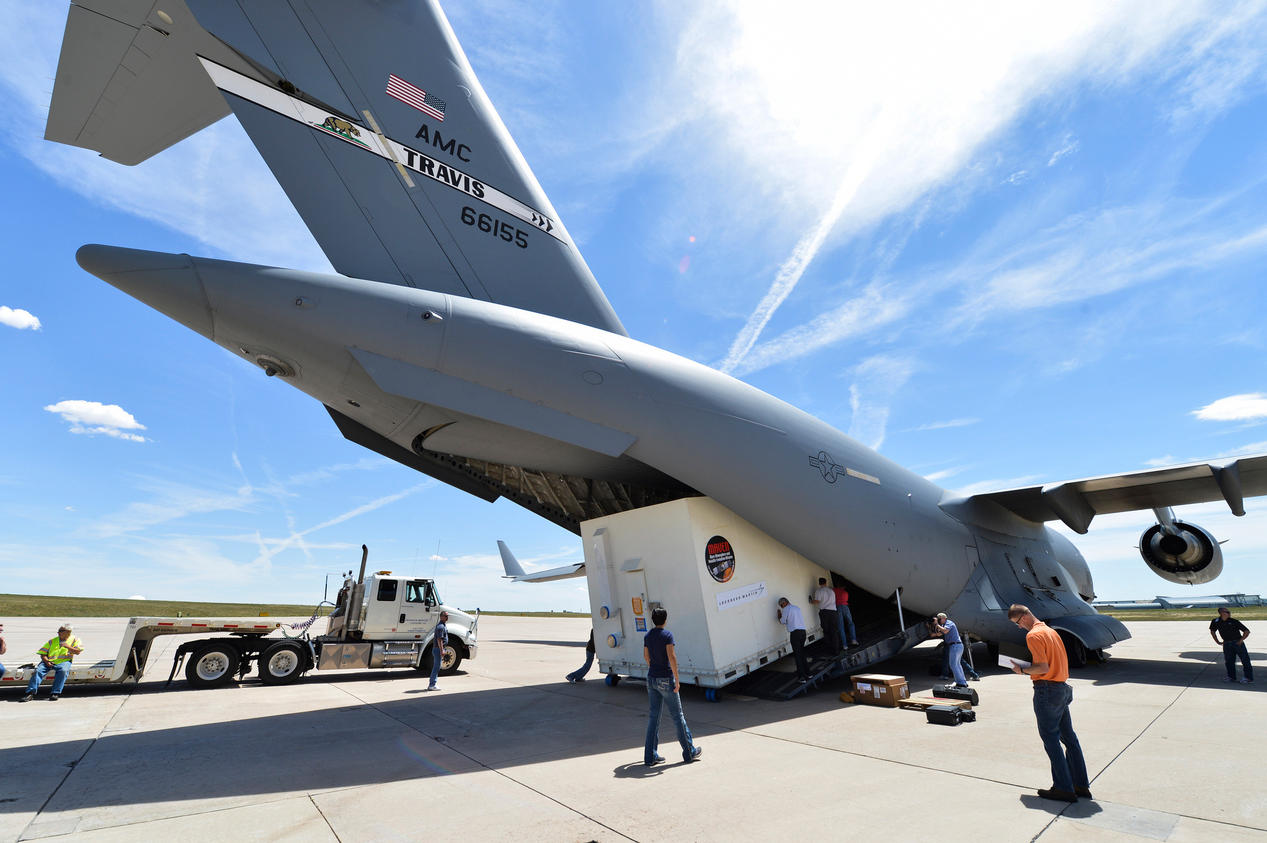 The MAVEN spacecraft is loaded into the belly of a C-17 Globemaster at Buckley Air Force Base in Aurora, Colorado on its way to Cape Canaveral, Florida, where it will be prepared for a November 18th launch date