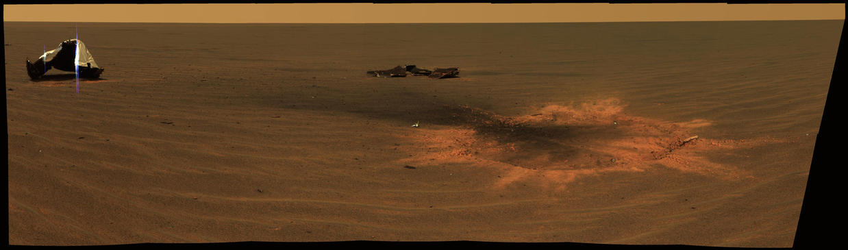 This stunning image features the heat shield impact site of NASA's Mars Exploration Rover Opportunity.