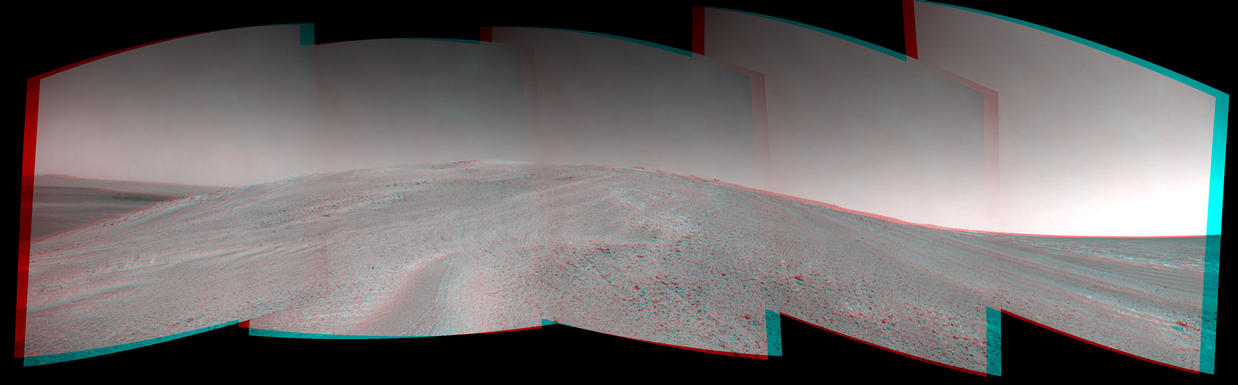 "NASA's Mars Exploration Rover Opportunity captured this stereo view after beginning to ascend the northwestern slope of ""Solander Point"" on the western rim of Endeavour Crater."