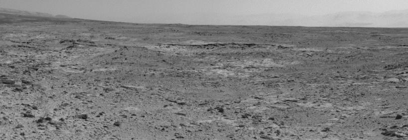 "The low ridge that appears as a dark band below the horizon in the center of this scene is a Martian outcrop called ""Cooperstown,"" a possible site for contact inspection with tools on the robotic arm of NASA's Mars rover Curiosity."