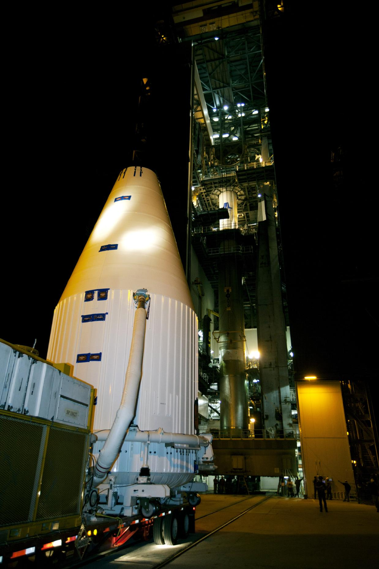 A transporter moves NASA's MAVEN spacecraft, inside a payload fairing, to the Vertical Integration Facility at Launch Complex 41 where it will be hoisted atop a United Launch Alliance Atlas V rocket that will boost it into space and on to Mars.