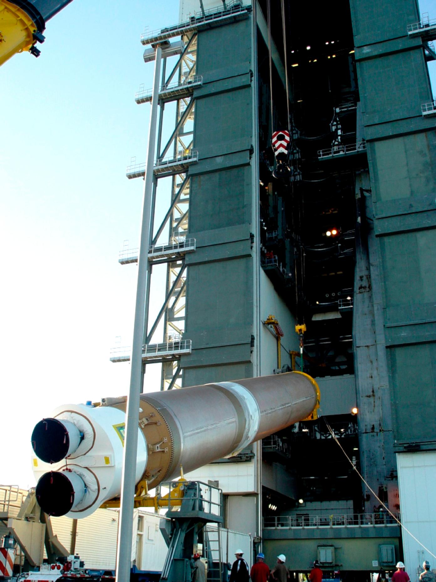 At Cape Canaveral Air Force Station in Florida, the United Launch Alliance Atlas V first stage is lifted for stacking at Launch Pad 41 in preparation for the Mars Atmosphere and Volatile Evolution, or MAVEN, mission.
