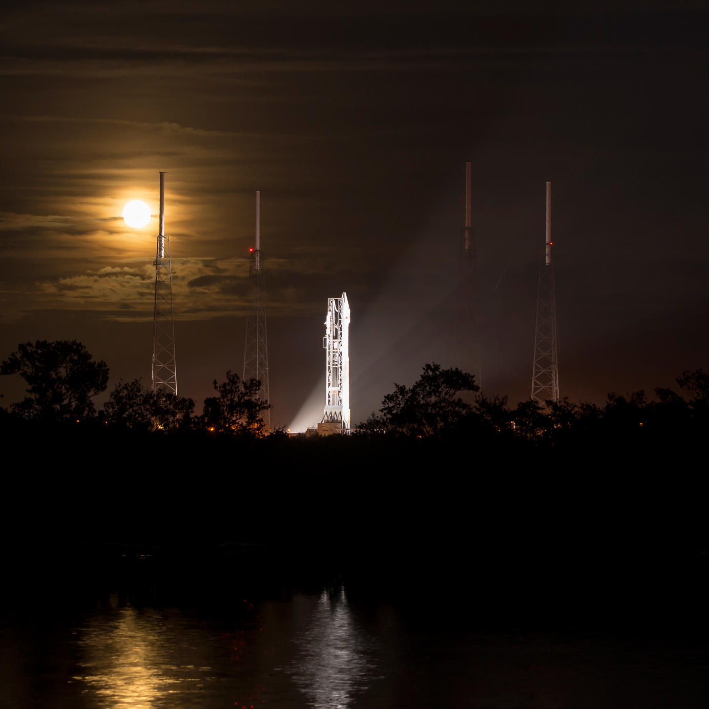 A full moon rises behind the United Launch Alliance Atlas V rocket with NASA's Mars Atmosphere and Volatile EvolutioN (MAVEN) spacecraft onboard at the Cape Canaveral Air Force Station Space Launch Complex 41, Cape Canaveral, Fla. on Nov. 17, 2013.