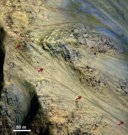 This image includes an especially long example of a type of dark marking that advances down some Martian slopes in warmer months and fades away in cooler months.