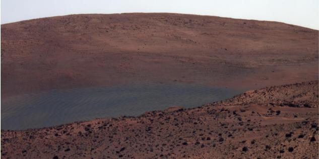 "NASA's Mars Exploration Rover Spirit has this view northward from the position at the north edge of the ""Home Plate"" plateau where the rover will spend its third Martian winter."