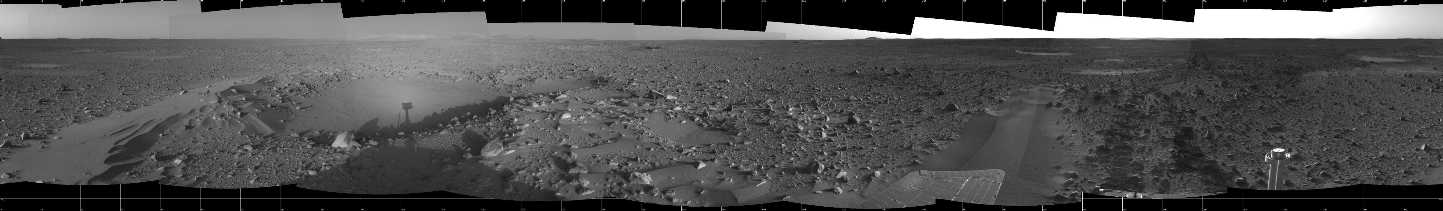 This image highlights the bumpy terrain surrounding the rover.