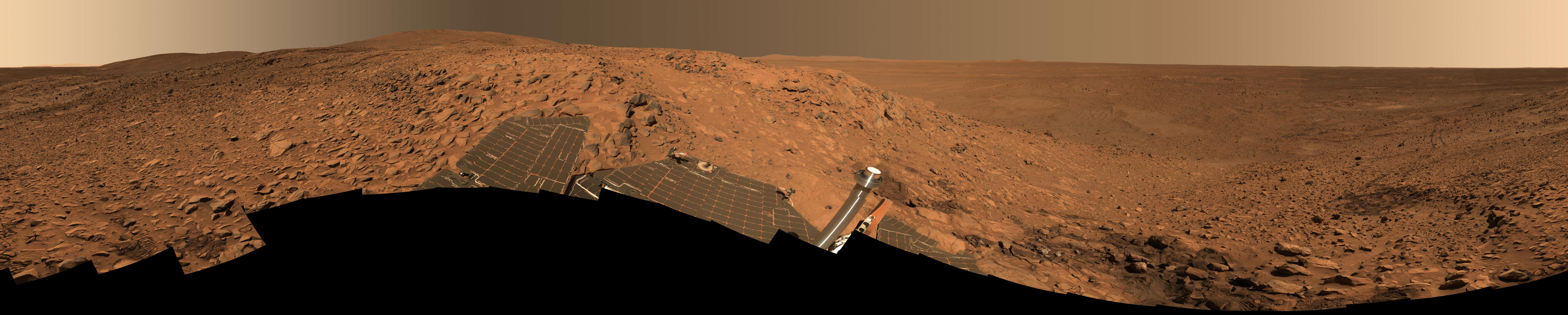 "This stunning image mosaic of the ""Columbia Hills"" is the first 360-degree panorama taken since the Mars Exploration Rover Spirit arrived at the hills over a month ago."