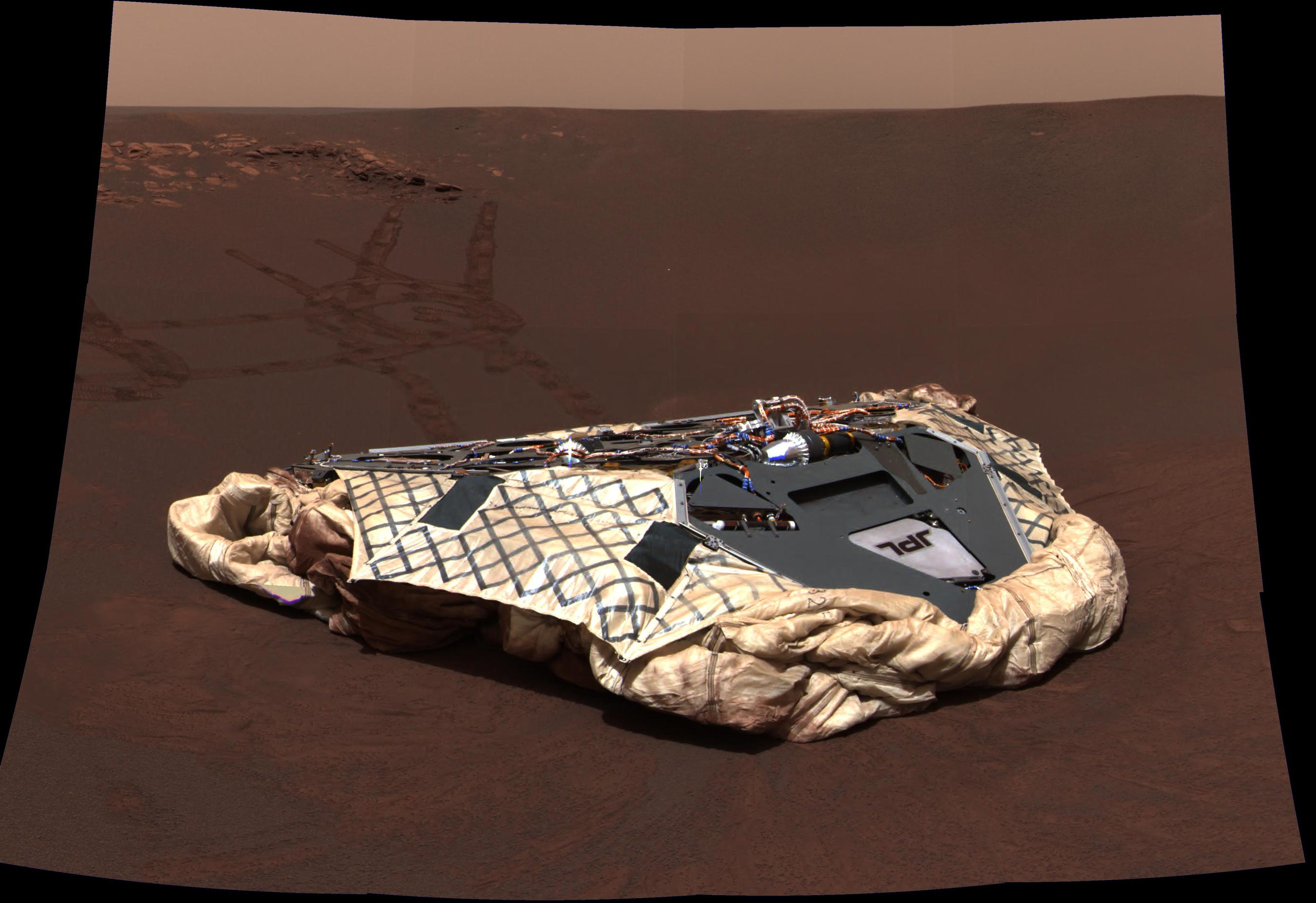 This image taken by the panoramic camera onboard Opportunity shows the rover's now-empty lander, the Challenger Memorial Station, at Meridiani Planum, Mars.