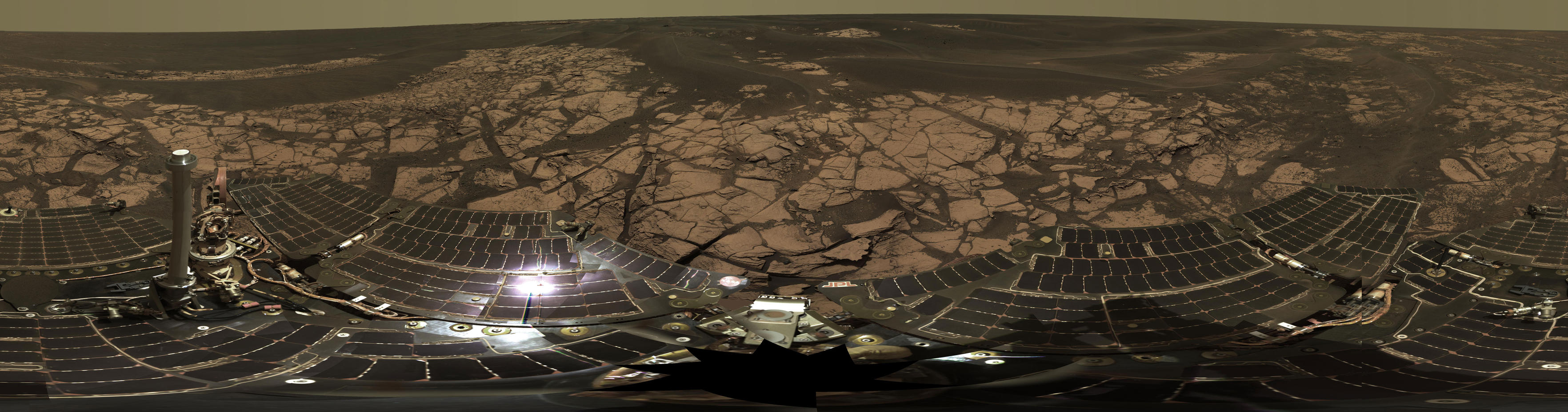"This is the Opportunity ""Erebus Rim"" panorama, acquired on sols 652 to 663 (Nov. 23 to Dec. 5, 2005 ), as Opportunity was exploring sand dunes and outcrop rocks in Meridiani Planum."