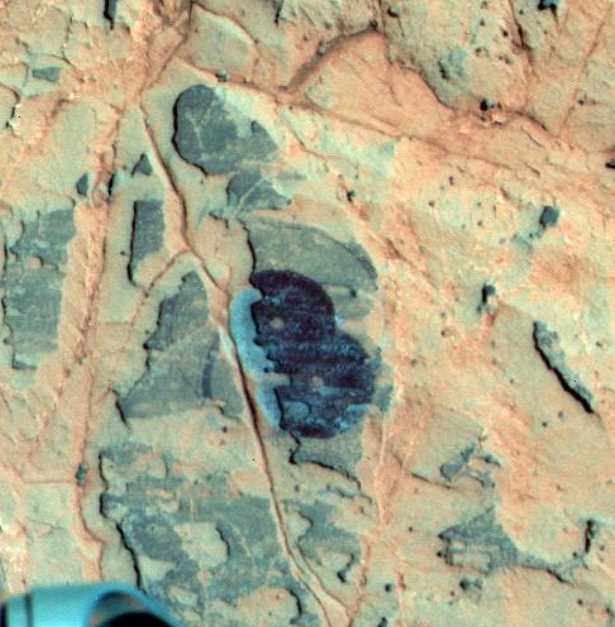 Researchers used NASA's Mars Exploration Rover Opportunity to find a water-related mineral on the ground that had been detected from orbit, and found it in the dark veneer of rocks on the rim of Endeavour Crater.