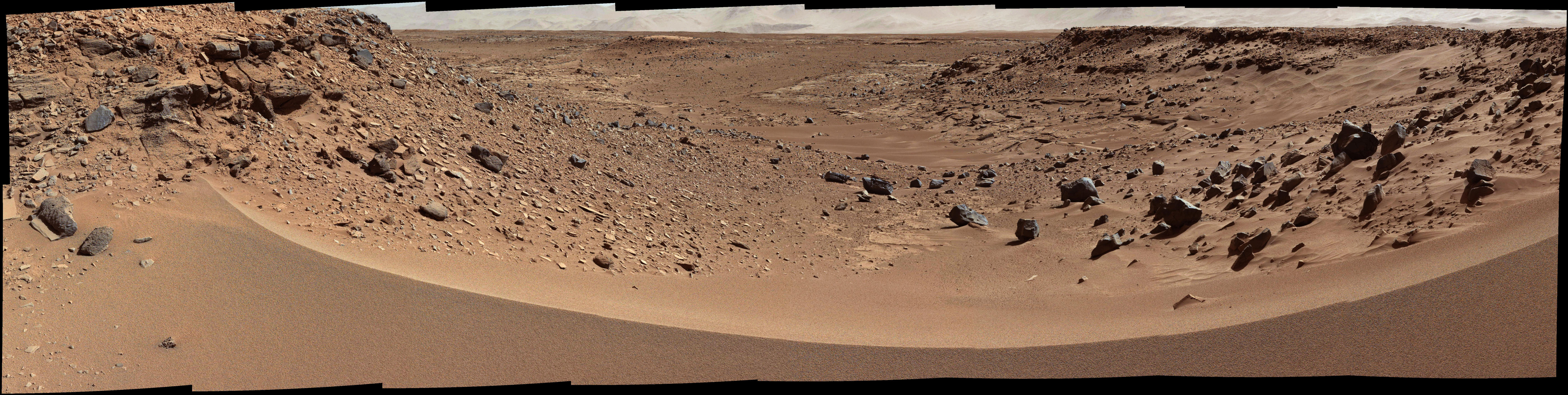 This view combines several frames taken by the Mast Camera (Mastcam) on NASA's Mars rover Curiosity, looking into a valley to the west from the eastern side of a dune at the eastern end of the valley.