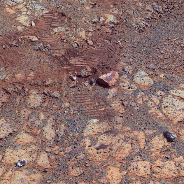 "This image from the panoramic camera (Pancam) on NASA's Mars Exploration Rover Opportunity shows where a rock called ""Pinnacle Island"" had been before it appeared in front of the rover in early January 2014."