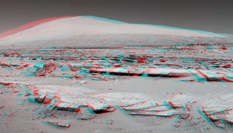 This stereo landscape scene from NASA's Curiosity Mars rover shows rows of rocks in the foreground and Mount Sharp on the horizon.