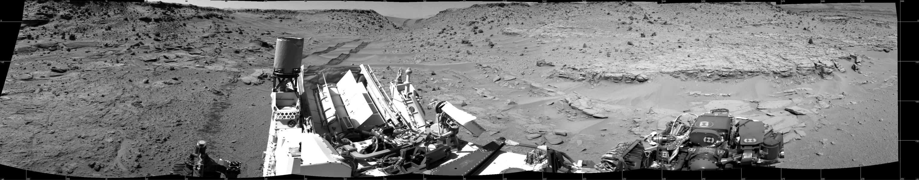 "This panorama combining images taken on Feb. 10, 2014, by the Navigation Camera (Navcam) on NASA's Curiosity Mars rover looks back to where the rover crossed a dune at ""Dingo Gap"" four days earlier. The view is centered toward the east and spans about 225 degrees."