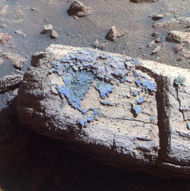 "This image from the panoramic camera on NASA's Mars Exploration Rover Opportunity shows a rock called ""Chocolate Hills,"" which the rover found and examined at the edge of a young crater called ""Concepción."""