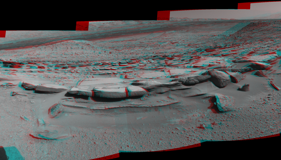 "This 160-degree, stereo view from NASA's Curiosity Mars rover is centered southward toward a planned science waypoint at ""the Kimberley,"" with an outcrop of eroded sandstone in the foreground."