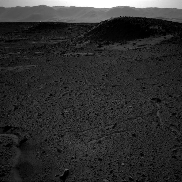 This image from NASA's Curiosity Mars rover, taken on April 3, 2014, includes a bright spot near the upper left corner. Possible explanations include  a glint from a rock or a cosmic-ray hit.