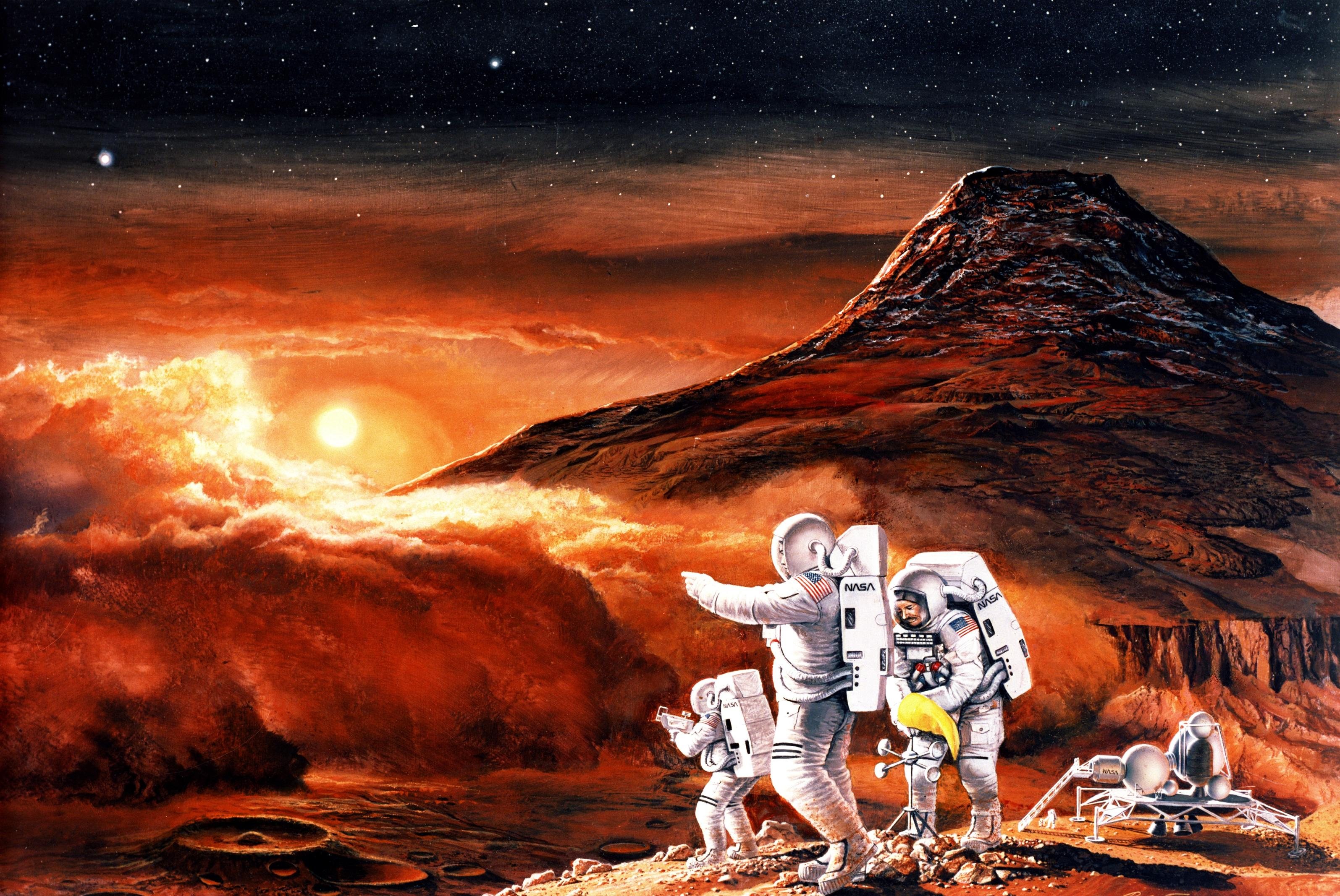 In this artist's concept, astronauts work on Mars' surface with Martian moons Phobos and Deimos visible in the sky.