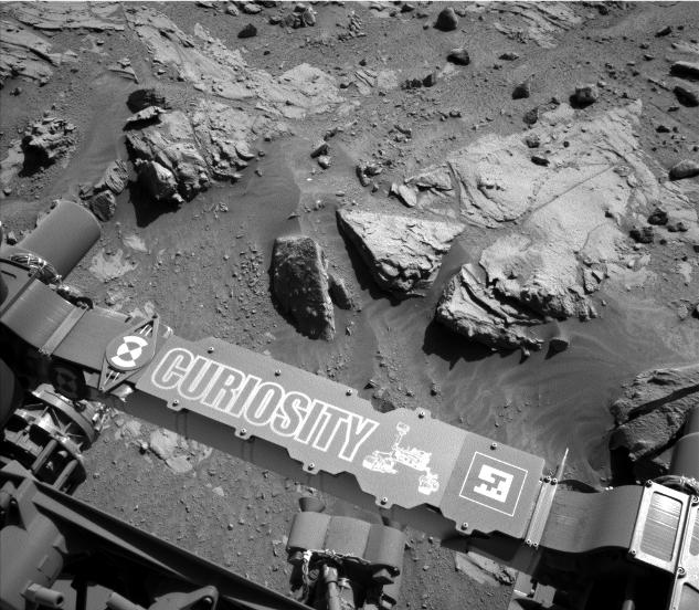 "This image from the Navigation Camera on NASA's Curiosity Mars rover shows a sandstone slab on which the rover team has selected a target, ""Windjana,"" for close-up examination."