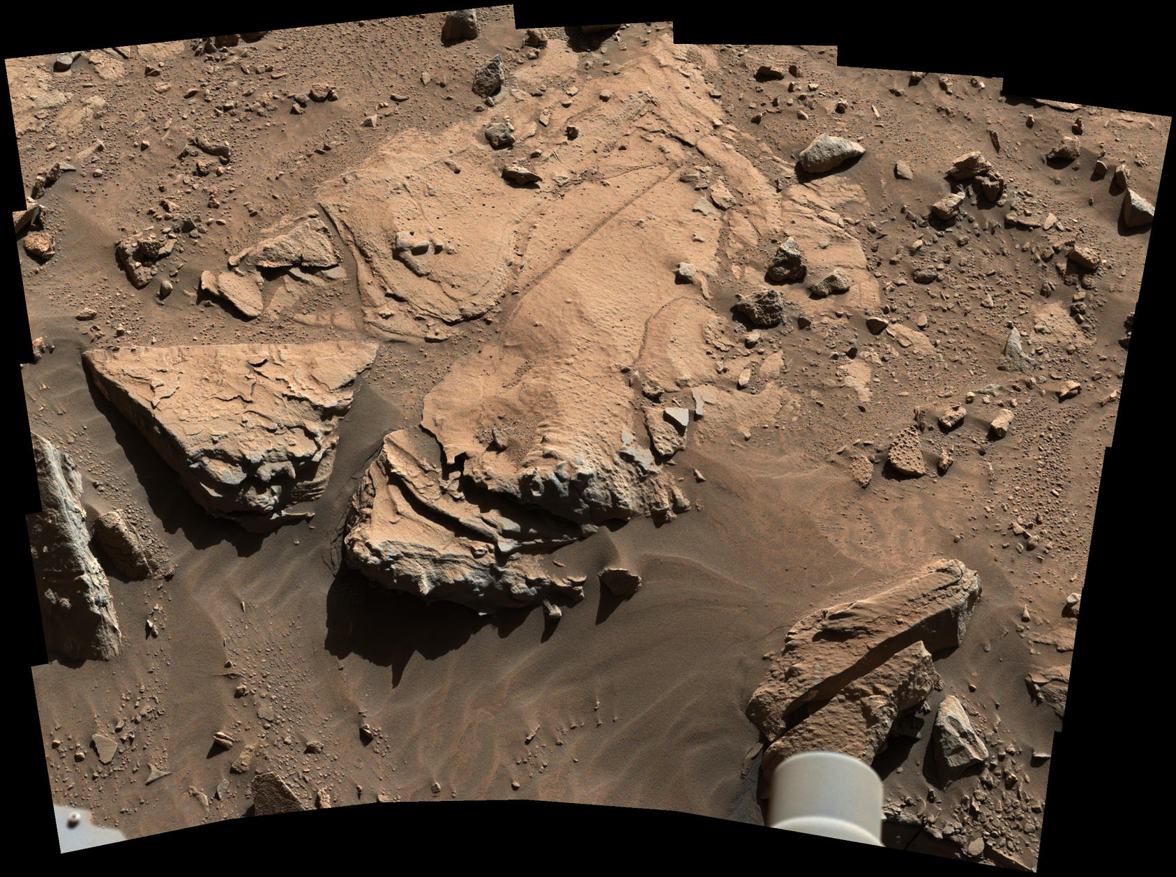 NASA's Curiosity Mars rover has driven within robotic-arm's reach of the sandstone slab at the center of this April 23 view from the rover's Mast Camera.