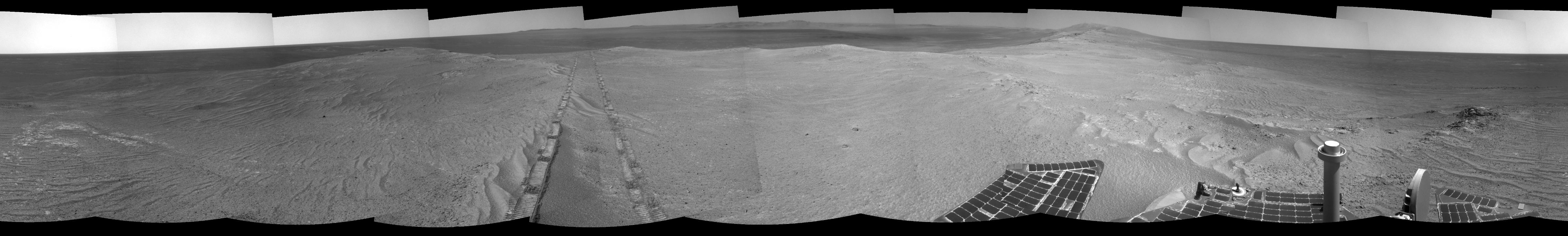 The component images for this 360-degree panorama were taken by the navigation camera on NASA's Mars Exploration Rover Opportunity after the rover drove about 97 feet southeastward on April 22, 2014. The location is on the western rim of Endeavour Crater. The two parallel tracks are 3.3 feet apart.