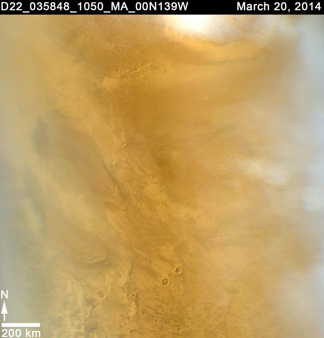 This March 20, 2014, image from the MARCI camera on NASA's Mars Reconnaissance Orbiter has a dark spot (at center of inscribed rectangle) noticed while the image was being examined for a weather report. Other observations confirmed that the spot is a scar from a space rock hitting Mars in 2012.