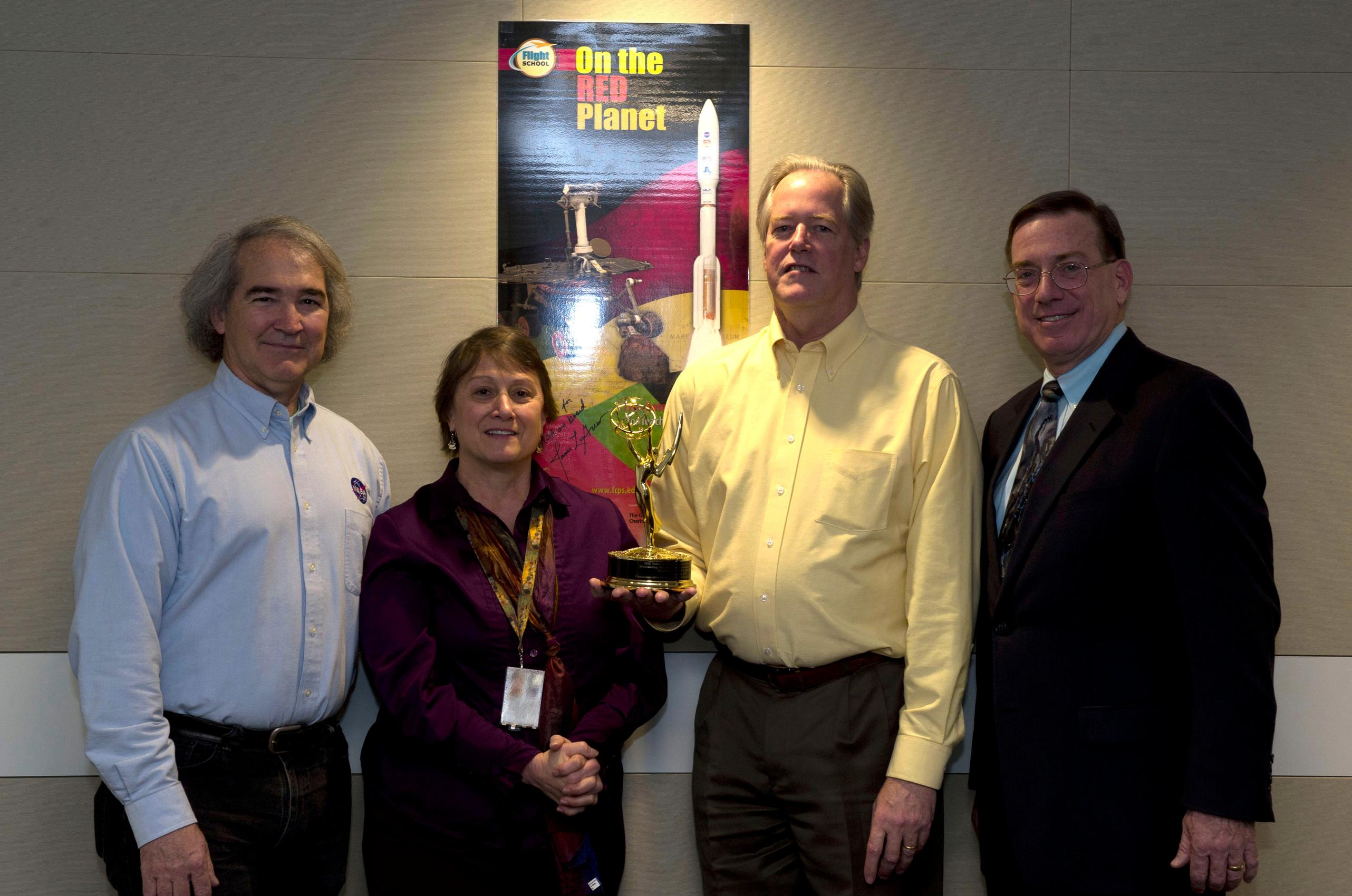 NASA Mars Exploration Program and NASM contributors pose with the Emmy statue.