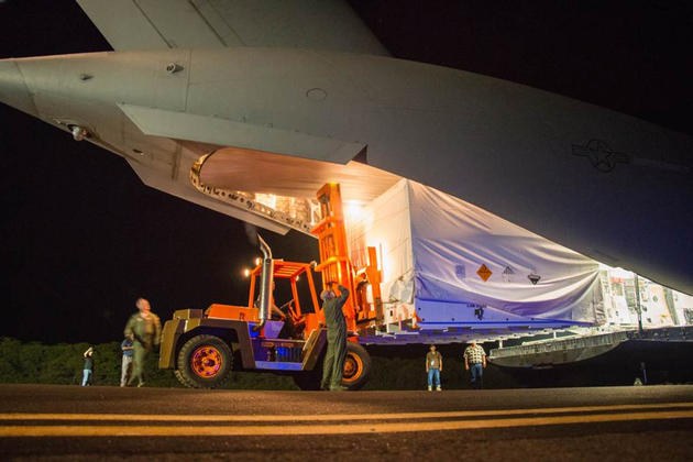 Engineers unload ground support equipment for a June engineering test flight above Kauai, Hawaii.