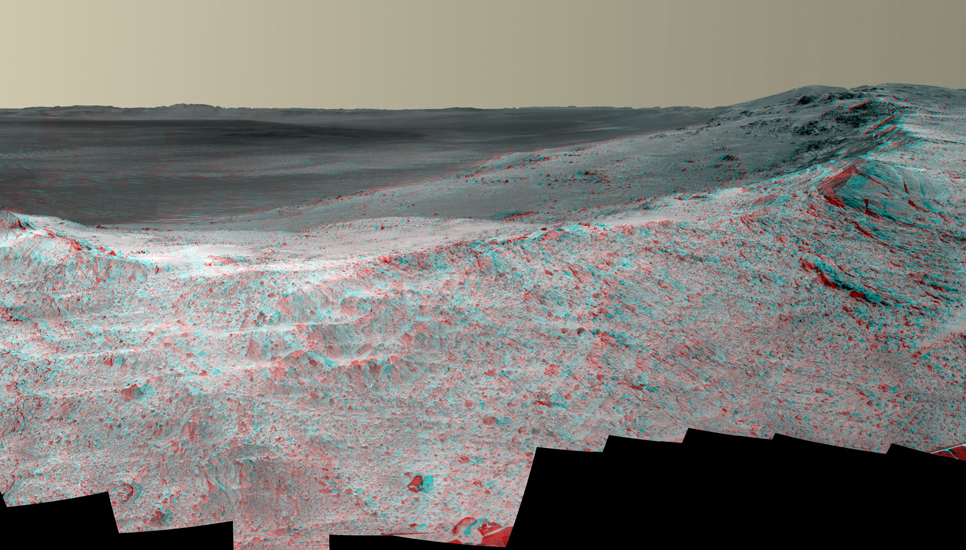 "This stereo vista from the panoramic camera (Pancam) of NASA's Mars Exploration Rover Opportunity catches ""Pillinger Point,"" on the western rim of Endeavour Crater, in the foreground."