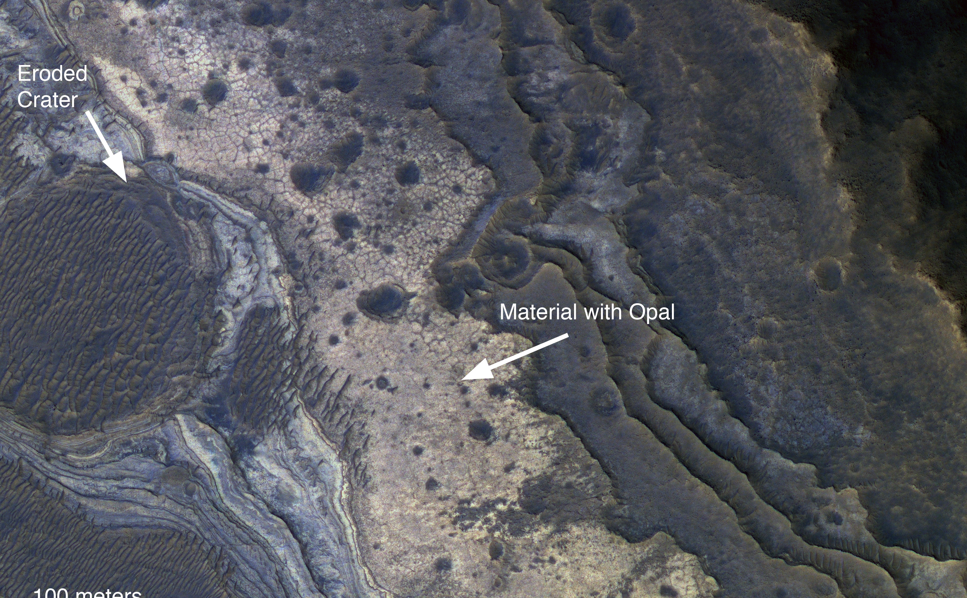 NASA's Mars Reconnaissance Orbiter has revealed Martian rocks containing a hydrated mineral similar to opal. The rocks are light-toned and appear cream-colored in this false-color image taken by the High Resolution Imaging Science Experiment camera. Images acquired by the orbiter reveal that different layers of rock have different properties and chemistry. The opal minerals are located in distinct beds of rock outside of the large Valles Marineris canyon system and are also found in rocks within the canyon. The presence of opal in these relatively young rocks tells scientists that water, possibly as rivers and small ponds, interacted with the surface as recently as two billion years ago, one billion years later than scientists had expected. The discovery of this new category of minerals spread across large regions of Mars suggests that liquid water played an important role in shaping the planet's surface and possibly hosting life.