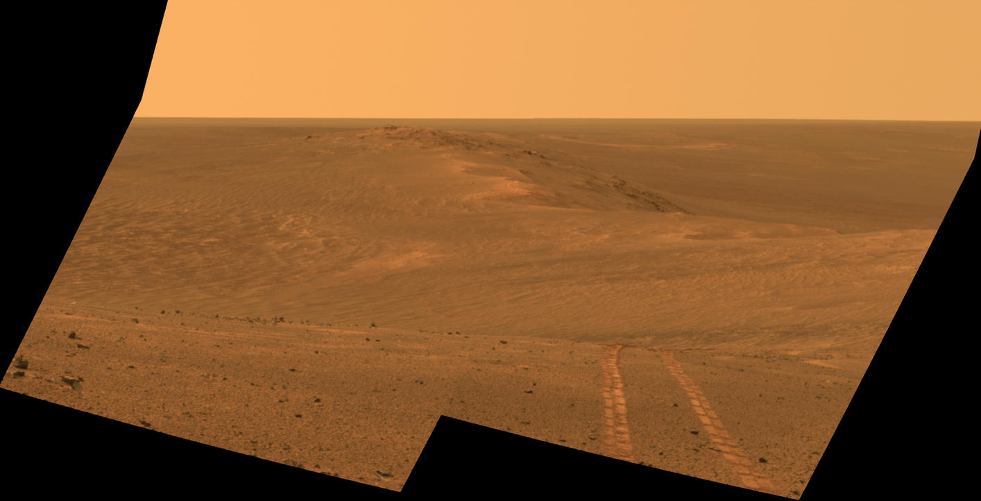 This scene from the Pancam on NASA's Mars Exploration Rover Opportunity looks back toward part of the west rim of Endeavour Crater that the rover drove along, heading southward, during the summer of 2014. It combines exposures taken on Aug. 15, 2014, and is presented in approximate true color.
