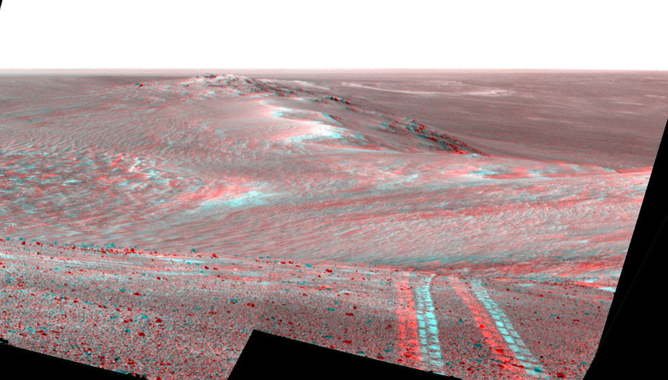 This scene from the panoramic camera (Pancam) on NASA's Mars Exploration Rover Opportunity looks back toward part of the west rim of Endeavour Crater that the rover drove along, heading southward, during the summer of 2014.