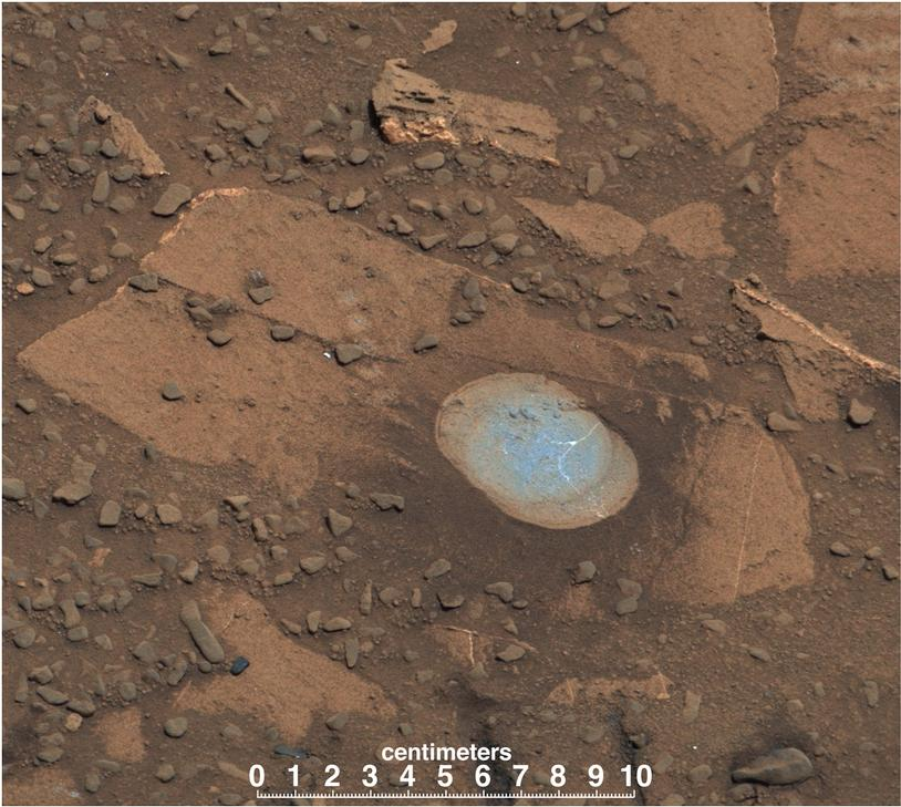 This image shows Bonanza King rock with a brown surface and in the middle is a partly drilled spot shown in lighter blue.