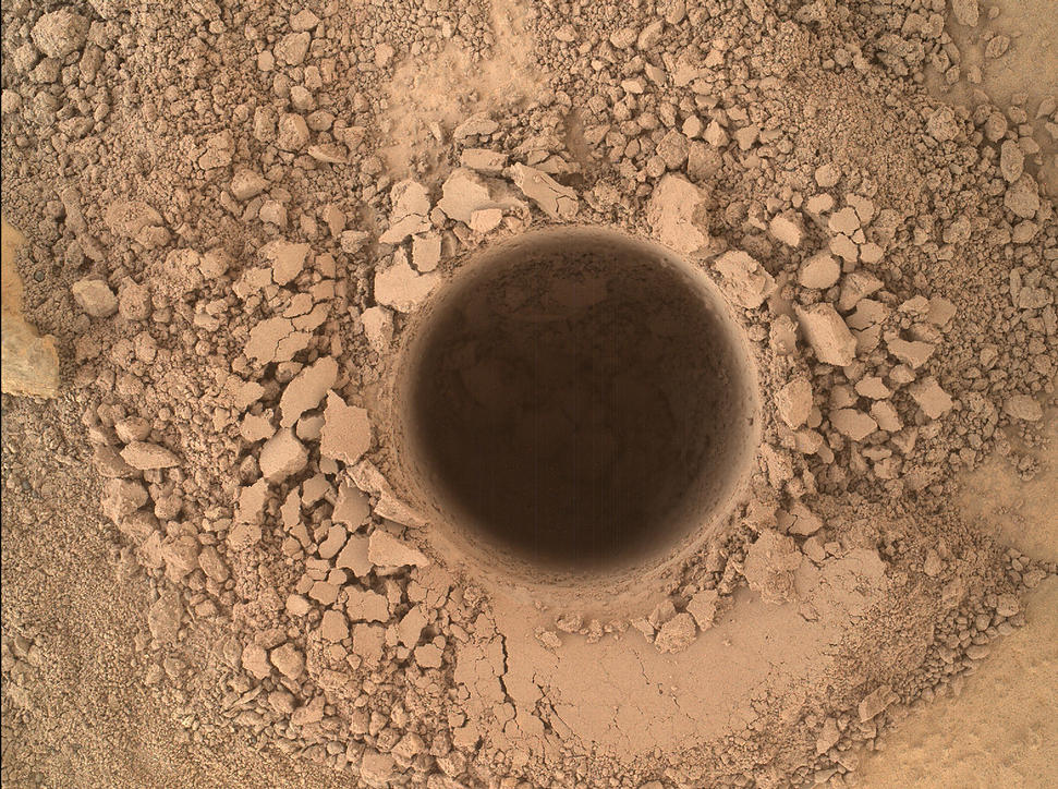 This image from the Mars Hand Lens Imager (MAHLI) camera on NASA's Curiosity Mars rover shows the first sample-collection hole drilled in Mount Sharp, the layered mountain that is the science destination of the rover's extended mission.