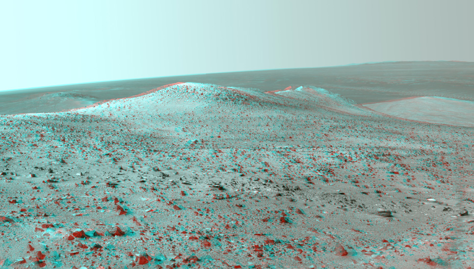"This stereo vista from NASA's Mars Exploration Rover Opportunity shows ""Wdowiak Ridge,"" from left foreground to center, as part of a northward look with the rover's tracks visible at right."