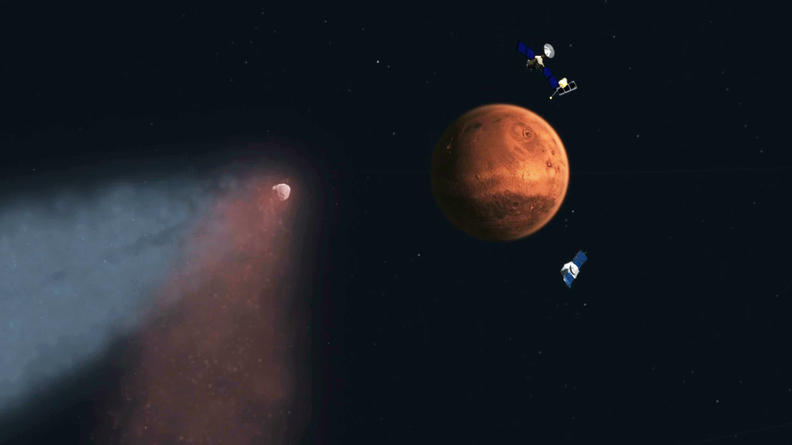 Artist's concept of Comet Siding Spring approaching Mars, shown with NASA's orbiters preparing to make science observations of this unique encounter.