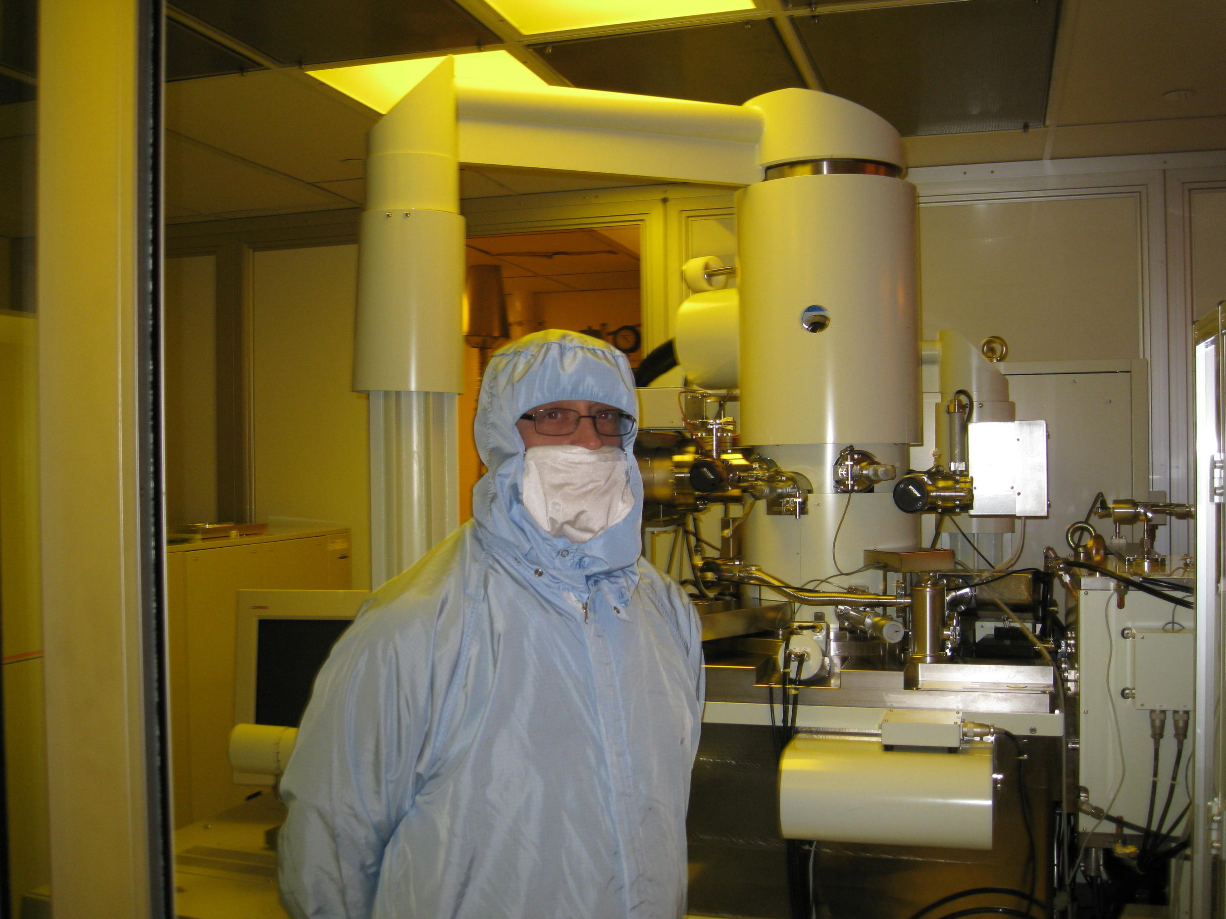 Richard Muller in front of the e-beam lithography tool that wrote over 1.3 million names on the microchip that will fly on Orion.