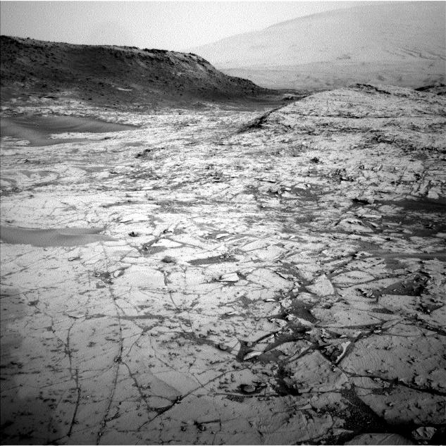 "The first demonstration of NASA's MAVEN Mars orbiter's capability to relay data from a Mars surface mission, on Nov. 6, 2014, included this and other images from NASA's Curiosity Mars rover. The image was taken Oct. 23, 2014, by Curiosity's Navigation Camera, showing part of ""Pahrump Hills"" outcrop."