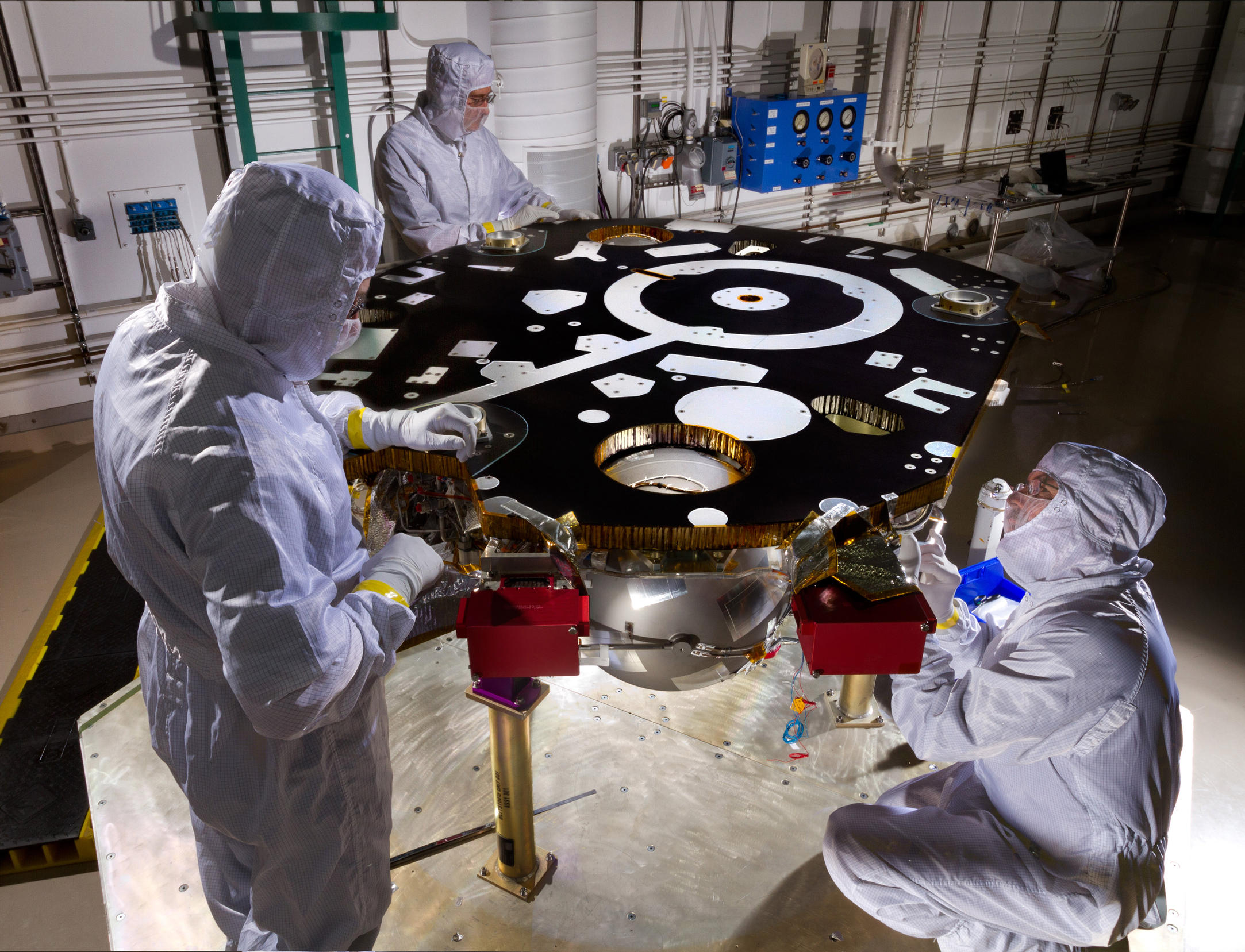 Technicians in a Lockheed Martin clean room near Denver prepare NASA's InSight Mars lander for propulsion proof and leak testing on Oct. 31, 2014.