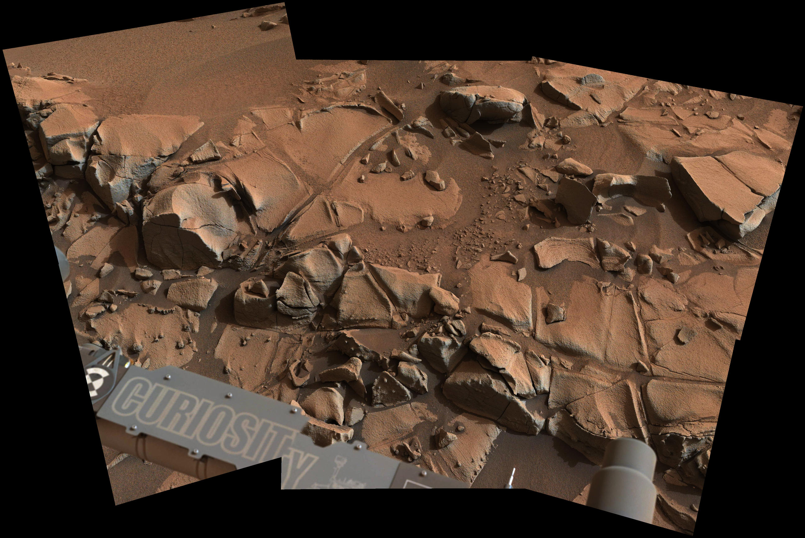"This view from the Mast Camera (Mastcam) on NASA's Curiosity Mars rover shows a swath of bedrock called ""Alexander Hills,"" which the rover approached for close-up inspection of selected targets. It is a mosaic of six frames taken on Nov. 23, 2014."