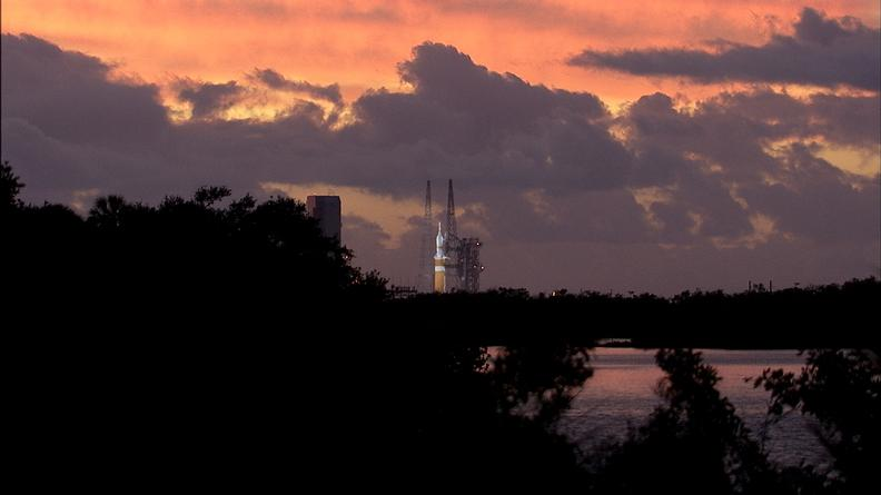 This image was taken on December 4, 2014 with the Orion spacecraft and Delta IV Heavy rocket, awaiting for launch as the sun rises.