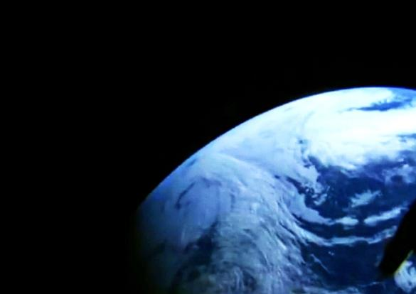 A camera in the window of NASA's Orion spacecraft looks back at Earth during its unpiloted flight test in orbit.