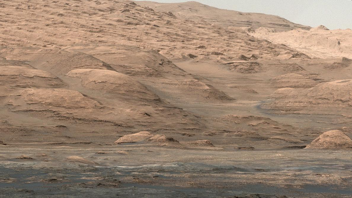 "This view from the Mastcam on NASA's Curiosity Mars rover shows dramatic buttes and layers on the lower flank of Mount Sharp. It was taken on Sept. 7, 2013, from near the waypoint called ""Darwin"" on the route toward an entry point to the mountain."